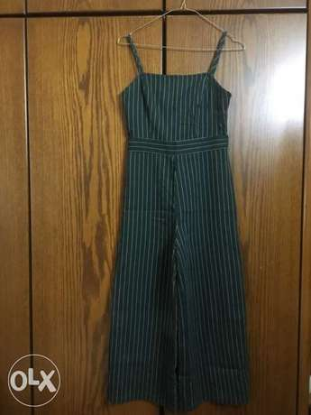 green jumpsuit with white strips