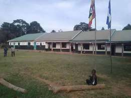 A primary school for sale in Kawuku at 600m