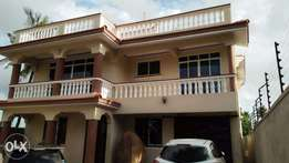 4 bedroom maisonette on 50ft by 100ft at utange