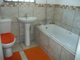 Four roomed house with garage & two outside rooms all for R5000 rental
