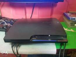 PlayStation 3 slim with FIFA 18, PES 18 and other installed games.