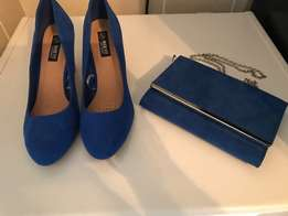 matching designer style dress shoes and clutch bag