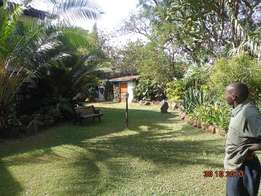 Njumbi rd 0.8Acre land on sewer with 4br house. for redevelopment,