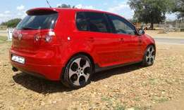 VW Golf 5 2.0 GTI DSG which is red in colour///R32000