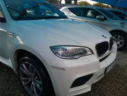 2013 BMW X6 M white in colour still looking new