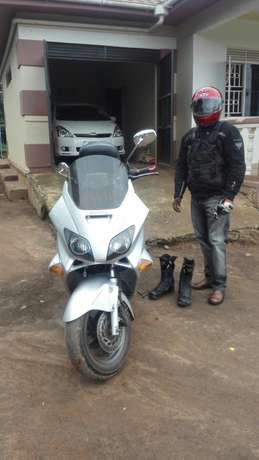Selling my Honda bike with all protective gears for your safety . Wakiso - image 1