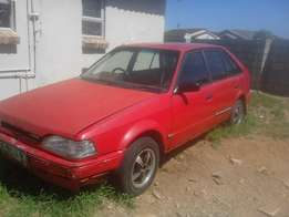 I'm selling a red mazda sting F6\1600 new engine '96 model with mags.