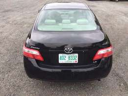 Super Clean Tokunbo Toyota Camry Le, Black colour with fur interior.