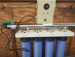 Whole house water purification system with UV Light