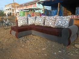 L shaped suede grey and brown sofa