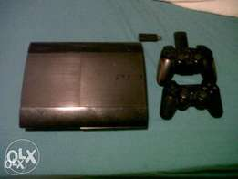 Playstation 3 with 2 controllers and 10 Games