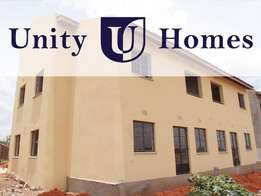 Ground floor home with private garden by Unity Homes, Eldoret
