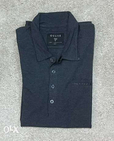 Guess polo shirt ( M fits S )