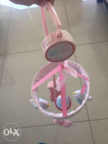 Bed toy hanger with music