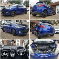 Mazda demio sports RSS version 1500cc with paddle shifts spoiler fogs