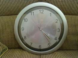Two silver colour wall clocks