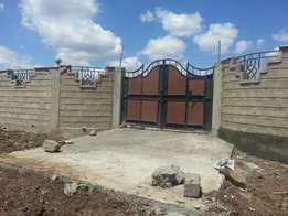 plot for for sale in membly with a perimeter wall at 7.8m