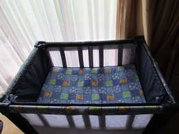 Camping cot with detachable bassinet