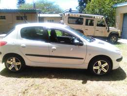 Selling Peugeot 206, 2006 Model. White and very clean.