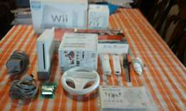 A wii console,accessories and 12 games for sale