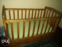 Three drawed baby cot
