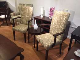 Twin upholstered chairs with coffee table