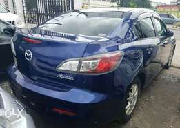Blue Mazda axela 2010 model on sale..