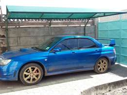 Mount car park shade on wall for 50000 kshs only