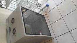 Server cabinet glass front with extractor fans