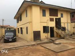 A story building of 4 rooms up/4 rooms down for sale at Ososami