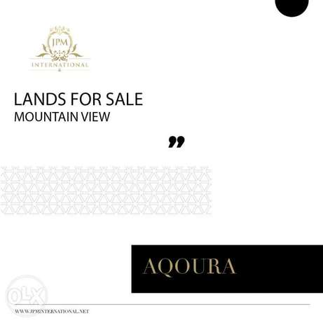Lands for sale in Aqoura-Banker check accepted-Call today!