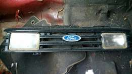 1985 Ford Cortina Grill with spotlights, needs some attention.