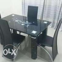 Padded glass dining table for 4