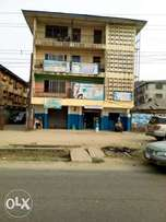 4 buildings in one compound located at a very attracted road in Aba