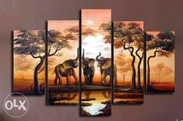 Elephants in sunset scene