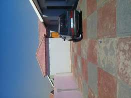 Very big room garage with tiles and ceiling sharing shower and toilet