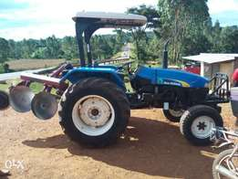 New Holland tt55 tractor and plough