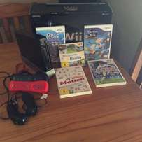 Wii + 6 games, 2 Remotes and 2 Nunchucks