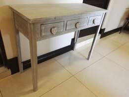 A three drawer server/dressing table
