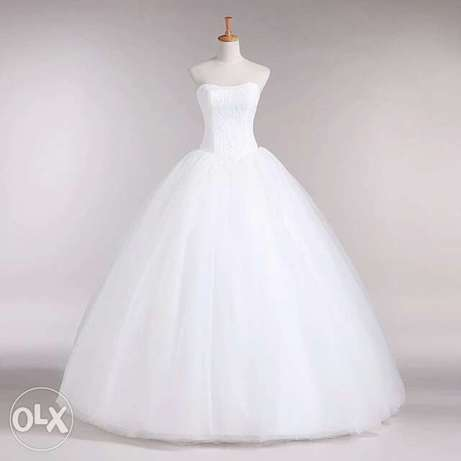 Very Classy Foreign Wedding Gowns. Uyo - image 7