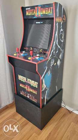 Arcade1up Mortal Kombat cabinet with riser like new backed in box