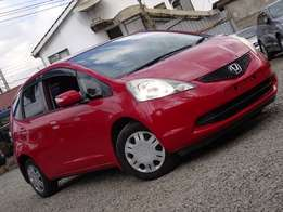 Honda Fit KCM, Red in colour. Loaded