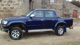 2002 Toyota Hilux, Double Cab, Diesel, Blue, with matching canopy.