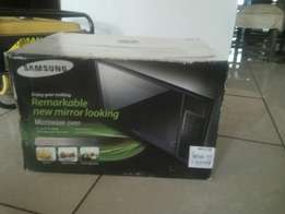 Remarkable brand new mirror looking microwave oven 1000watts for sale