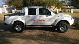 Beautiful 2003 Nissan Hardbody Double Cab 3.3i V6 4x4 for Sale.