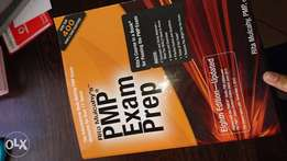 Pmp Exam prep book plus Hot topix booklet.
