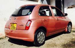 nissan march 2010 model KCL reg 1200cc fully loAded at 599,999/= o.n.o