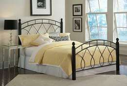 Steel bed with wood stands