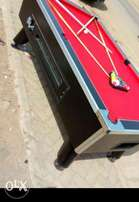 Pool table together with business premise