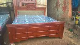 5 by 6 mahogany bed up for grabs
